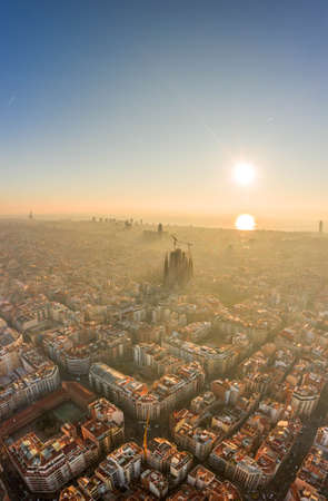 Aerial drone shot of sunrise over Barcelona city center in early morning