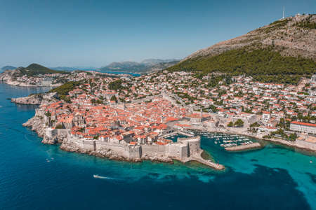 Aerial drone shot of Old Port in Dubrovnik old town in Croatia summer midday noon
