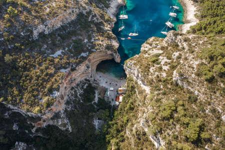 Aerial drone shot of Stiniva cove beach of Adriatic sea on Vis Island in Croatia summer