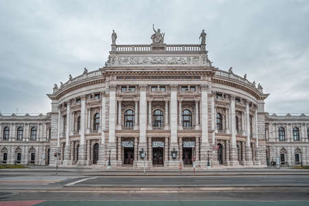 Vienna, Austria - Feb 7, 2020:Facade empty view of baroque style Burgtheater in front of city hall in winter morning