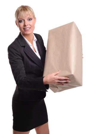 despatch: Lady with plain parcel Stock Photo