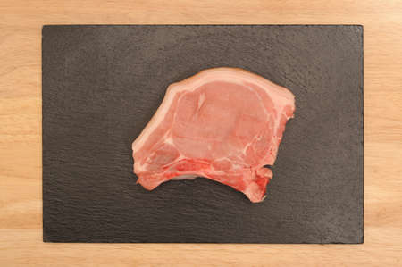 pork chop on a piece of slate 스톡 콘텐츠