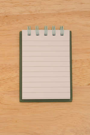 Note pad isolated on wooden surface