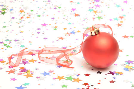 Christmas bauble on star shaped confetti