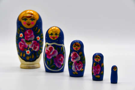 Classic Russian matryoshkas in row on put with white background