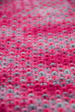 The structure of a colorful knitted scarf