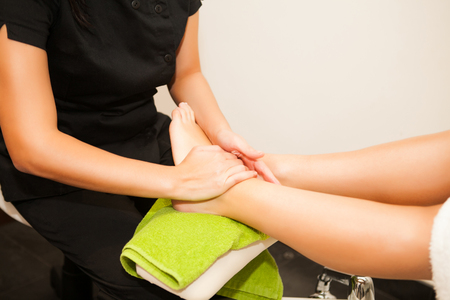 Feet massage during spa treatmen  photo