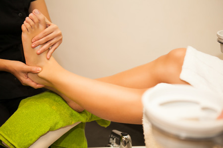 Feet massage during spa treatmen  Stock Photo - 23470853