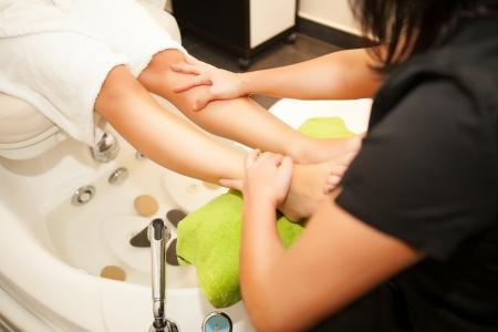 Feet massage during spa treatmen  Stock Photo - 23470851