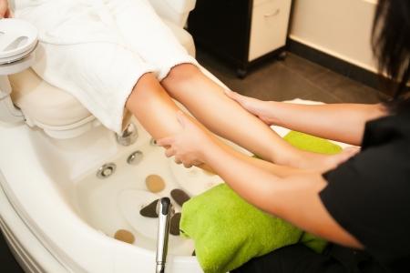 Feet massage during spa treatmen Stock Photo - 23470852