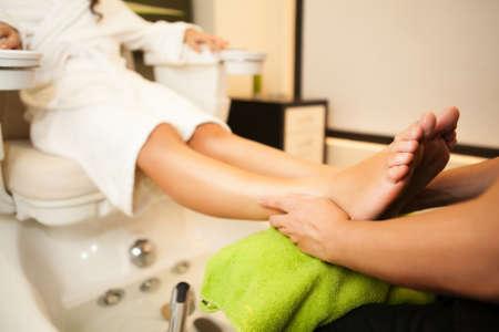 beauty therapist: Feet massage during spa treatmen  Stock Photo