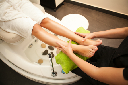 Feet massage during spa treatmen  Standard-Bild