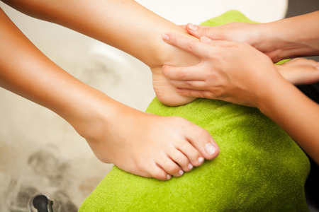 Feet massage during spa treatmen  Stock Photo