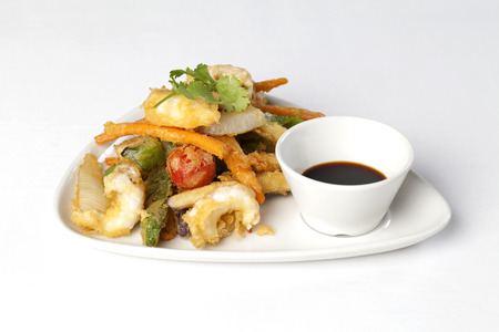 Shrimps and vegetables in tempura, with sauce  스톡 사진