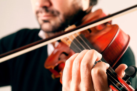 Musician playing violin in white background