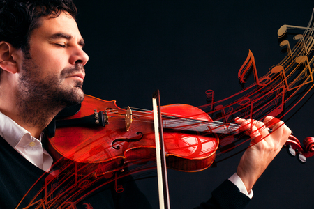 violinist: Violinist playing music Stock Photo