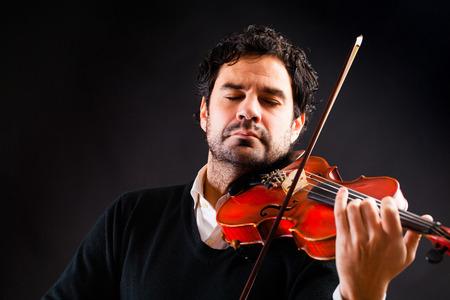 violinista: Reproducci�n de m�sica Violinista Foto de archivo