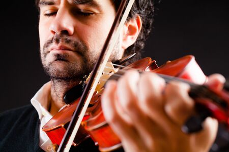 Violinist playing music Stock Photo