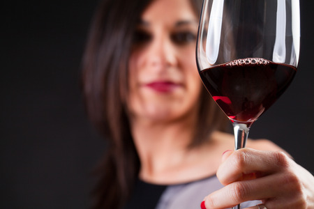 Woman looking at wine, during wine marriage process.