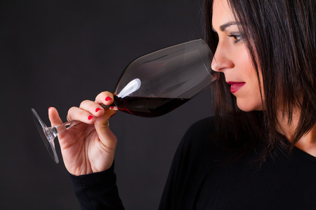Woman smelling a wine, during wine marriage process. Stock Photo