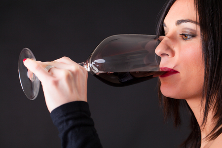 Woman tasting a wine, during wine marriage process.
