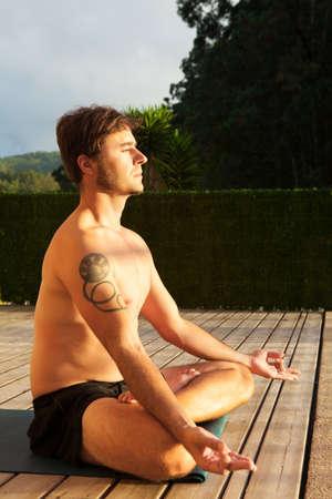 yoga outside: Man doing yoga outside. Stock Photo