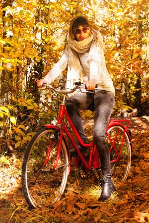 Girl in the forest with a bike.