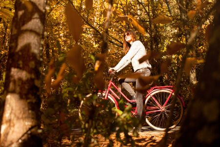sexy fashion: Woman with a bike in the middle of the forest Stock Photo