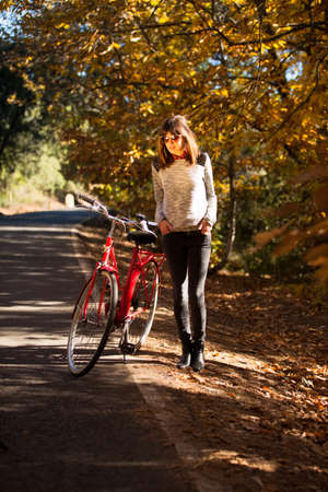 Girl posing with a classical bike