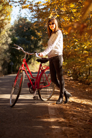 sexy young girls: Woman posing with a bike near to the forest Stock Photo