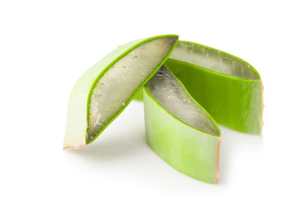 Close up of stack of freshly sliced Aloe Vera on white background 스톡 사진