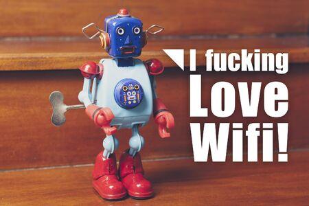 tin robot: I fucking love wifi text. Tin robot vintage toy. Stock Photo