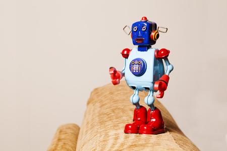 tin robot: Vintage tin robot on a sofa. Stock Photo