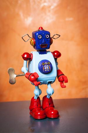 tin robot: Vintage tin robot on orange background.