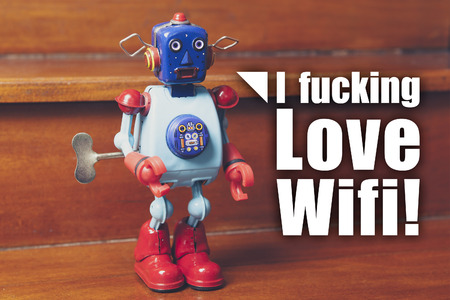 fucking: I fucking love wifi message. Vintage tin robot. Network concept.