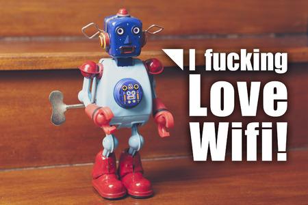 tin robot: I fucking love wifi message. Vintage tin robot. Network concept.