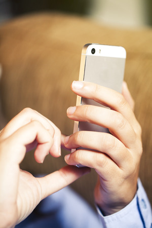 Woman hands holding a mobile phone. 스톡 사진