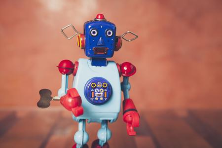 tin robot: Vintage tin robot with orange background.