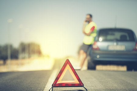 emergency vest: Emergency triangle. Man and his car in the background. Vintage style.