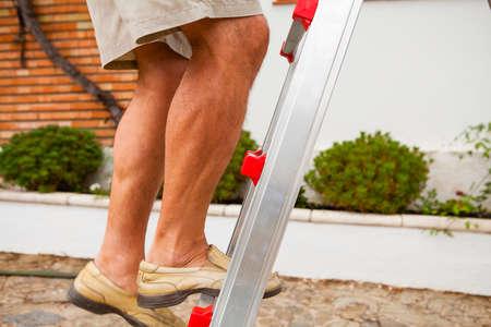 ladder: Man legs climbing a ladder.