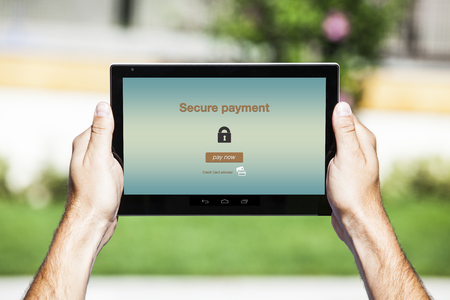 Secure payment displayed on tablet screen. 스톡 사진