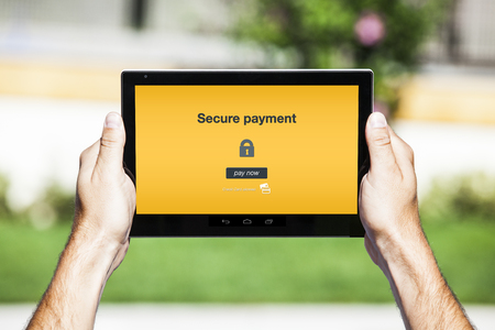 secure payment: Secure payment displayed on tablet screen. Stock Photo