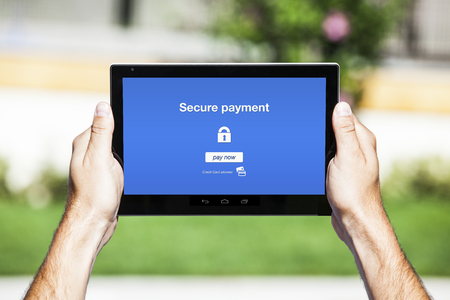 secure payment: Secure payment website on tablet screen.