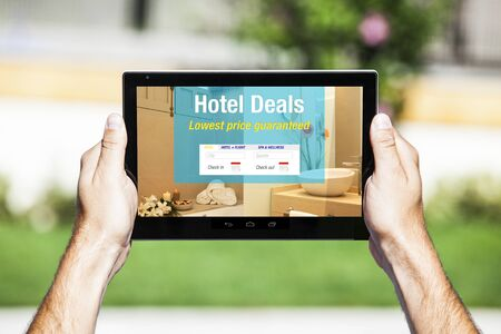hotel booking: Hotel deals website on a tablet. Stock Photo