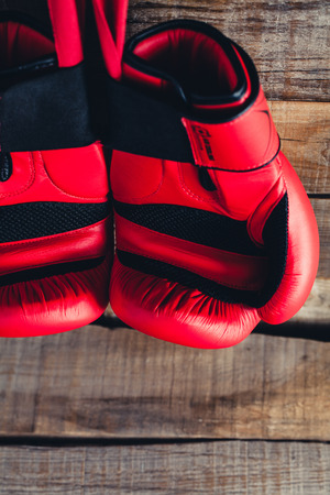 Pair of red boxing gloves.