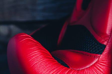 Close up detail of red boxing glove.