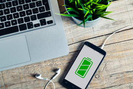green office: Full battery icon in a mobile phone screen. Stock Photo