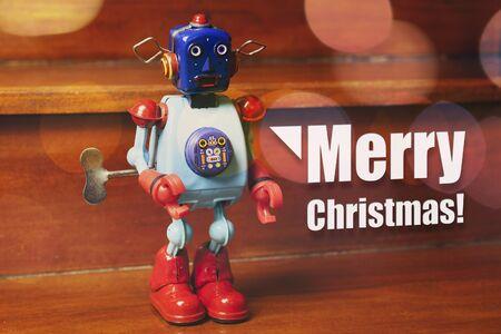 Christmas card, with vintage tin robot wishing Merry Christmas.