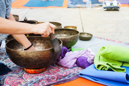 singing bowl: Tibetan bowls playing during a yoga session. Stock Photo