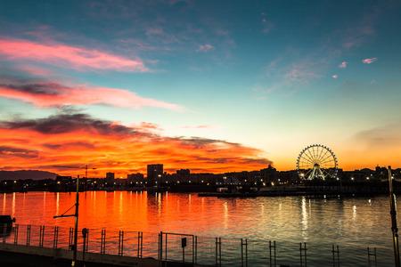 Stunning sunset in the marina port of Malaga, Spain. 스톡 사진